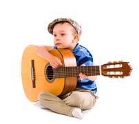 Boy and guitar Stock Photos