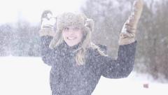 Happy women having fun in snow winter time slow motion Stock Footage