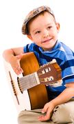 Stock Photo of boy and guitar