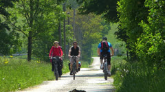 European Cyclist Biker cycling in countryside tree lane Stock Footage