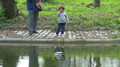 Child, Grandfather Feeding Ducks on Lake, Little Girl Playing in Park, Children Stock Footage