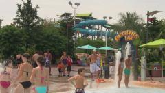 Visitors at Waterpark Walking Around Between Slides Stock Footage