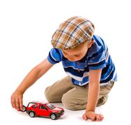 Boy and toy car Stock Photos