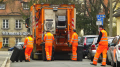T/L Trash collector collecting residential trash rubbish Garbage truck Stock Footage