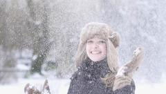 happy women exited playing spinning fun snow fall winter time slow motion - stock footage