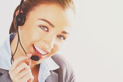 woman customer service agent proffessional telephone worker - stock photo