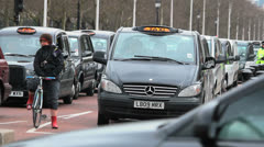 Traditional black cabs. Traffic in London, UK - England Stock Footage