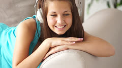 Cute teenager listeningto music and smiling Stock Footage