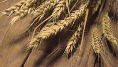 wheat on the old wooden background - stock footage