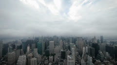 City night time lapse nyc skyline foggy clouds Stock Footage