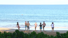 Group Workout on Sandy Beach Stock Footage