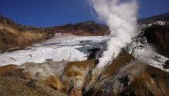 Stream and gas from fumarole in a crater of volcano Stock Footage