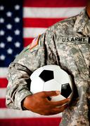 Stock Photo of soldier: holding a soccer ball