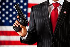 Stock Photo of politician: holding a gun aloft