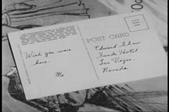 Close-up of postcard on table Stock Footage