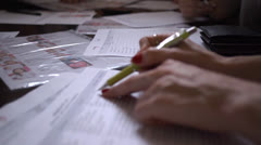 Filling out forms - stock footage
