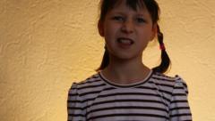 Girl chews gum Stock Footage