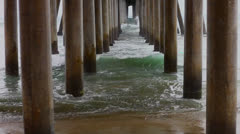Under the Huntington Beach Pier Stock Footage