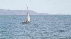 SailBoat 06 - Sailboat takes down it's sails. Stock Footage