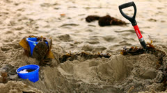 Pail and shovel in the sand - stock footage