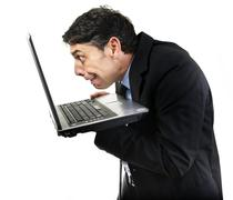 guilty man peering at x-rated content on his pc - stock photo