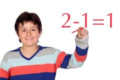 Adorable child student writing a math operation Stock Photos