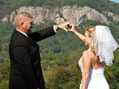 Bride and groom mountain heart - stock photo