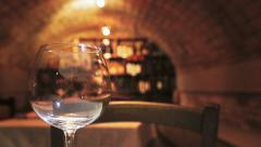 Foreground wine glass and restaurant cavern - stock footage