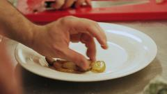 Chef serving food to the plate Stock Footage