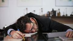 Businessman asleep miss an appointment Stock Footage