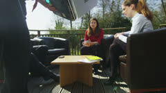 Business team meeting in office with natural outdoor area Stock Footage