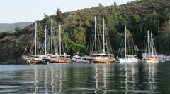 Yachts at the pier on Mediterranean turkish resort, Fethiye, Turkey Stock Footage