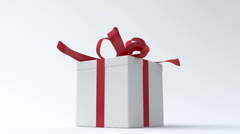 White gift box with red ribbon opening Stock Footage