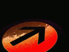 Bright directional sign on black background Stock Illustration
