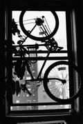 A bicycle hanging in a window Stock Photos
