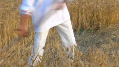 Stock Video Footage of Peasant reaping wheat with a scythe