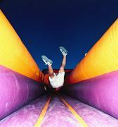 Boy jumping on trampoline Stock Photos