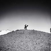 Snowboarder standing on a hill Stock Photos