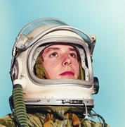 young man posing as an astronaut - stock photo