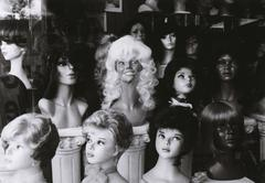 Mannequins with wigs in a wig shop Stock Photos