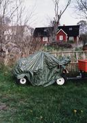 A covered trailer parked in the grass Stock Photos