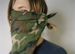 A young man with a bandana covering his face Stock Photos