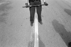 A policeman holding a baton Stock Photos
