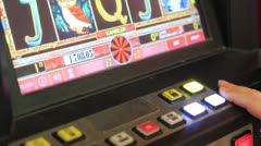 Playing poker-machines (video-poker) - stock footage