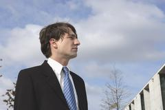 A businessman looking away Stock Photos