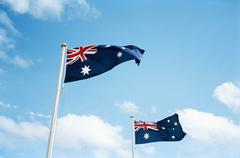 Two Australian flags blowing in the breeze Stock Photos