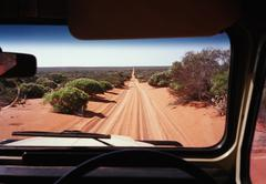 View of a desert road in Australia through the windshield of an off-road vehicle Kuvituskuvat