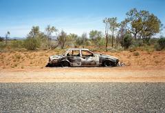 Hylätty auto puolella erämaatiellä, Australia Kuvituskuvat
