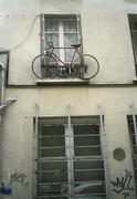 A bicycle attached to a windowsill Stock Photos