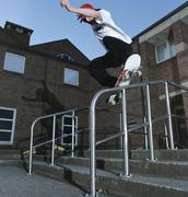 Man on skateboard balancing on railing Stock Photos
